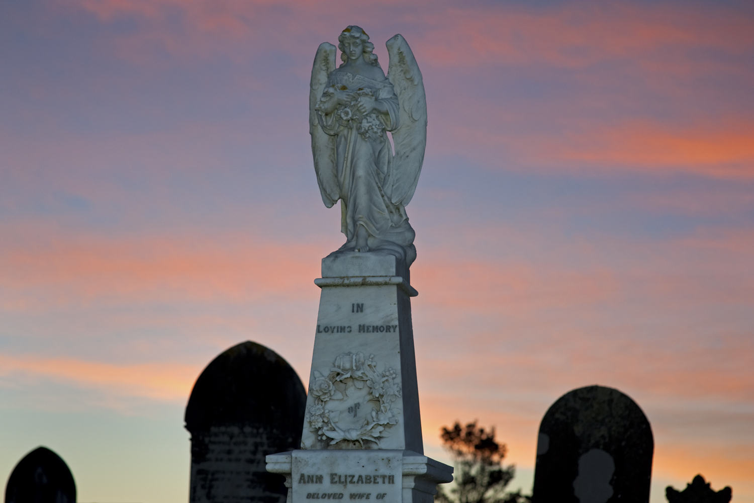 Angel at sunset, Karoro Cemetery, Greymouth